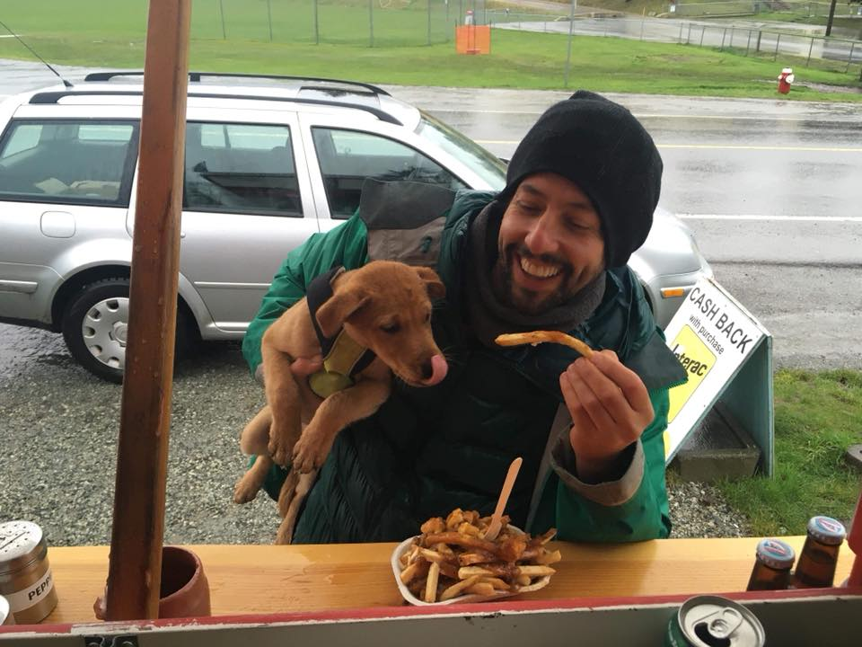 Al and his puppy Leo sharing a Poutine at Al's